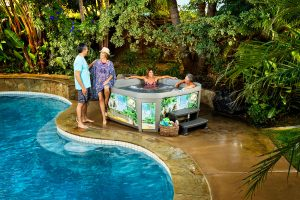 This is a lifestyle commercial photograph taken on location by Skip O'Donnell off ODonnell photograf of a customized Margaritaville hot tub for Watkins Spa in Carlsbad, San Diego, California